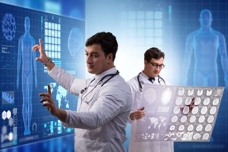 Doctor in telemedicine concept looking at x-ray image Stock Photo - 119944963