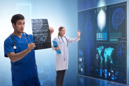 Doctor in telemedicine concept looking at x-ray image