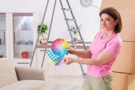 Woman choosing color for flat renewal Фото со стока - 119945862