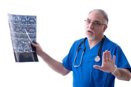White bearded old doctor radiologist working in clinic
