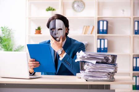 Male employee in the office in industrial espionage concept
