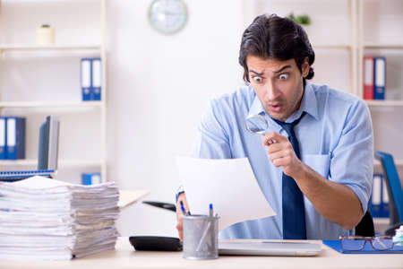 Young male businessman employee unhappy with excessive work Stockfoto