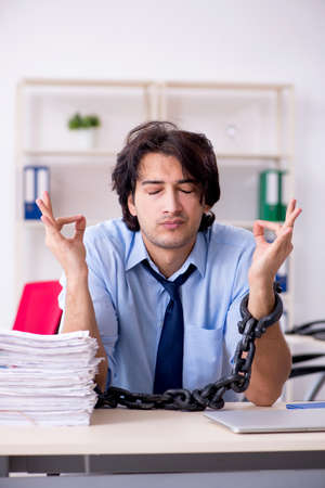 Young male businessman employee unhappy with excessive work