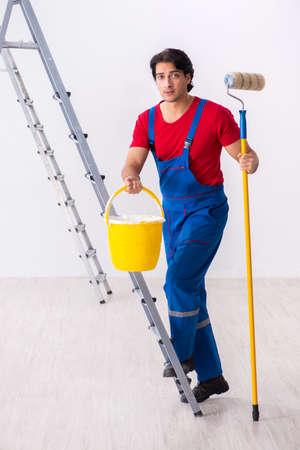 Young handsome contractor working indoors