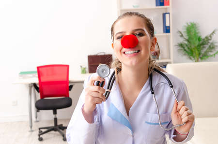 Funny female doctor working in the clinic