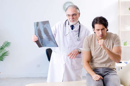 Young man visiting old male doctor radiologist