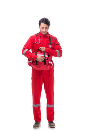 Young paramedic in red uniform isolated on white