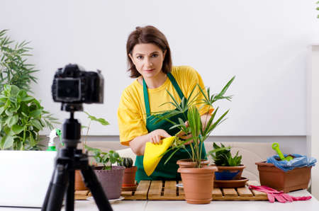 Female blogger explaining houseplants growing
