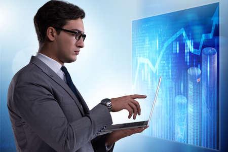 Businessman in futuristic stock trading concept Zdjęcie Seryjne