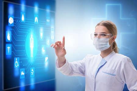 Woman doctor in telemedicine concept pressing touchscreen