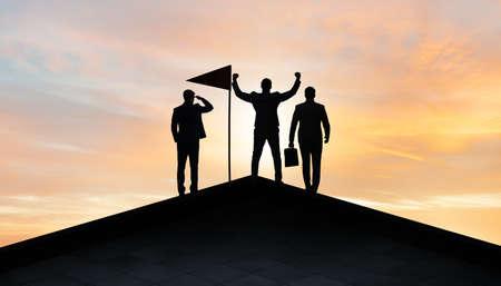 Businessmen in achievement and teamwork concept 版權商用圖片
