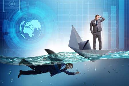 Uomini d'affari nel concetto di concorrenza con lo squalo