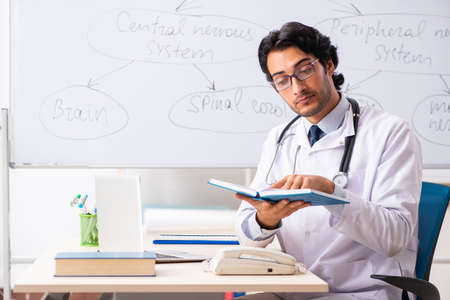 Young male doctor neurologist in front of whiteboard Stock Photo