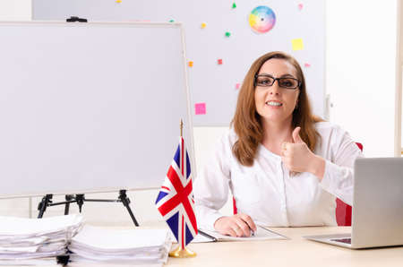 Female english language teacher in front of whiteboard