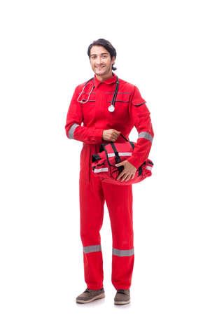 Junge Sanitäter in roter Uniform isoliert auf weiss Standard-Bild