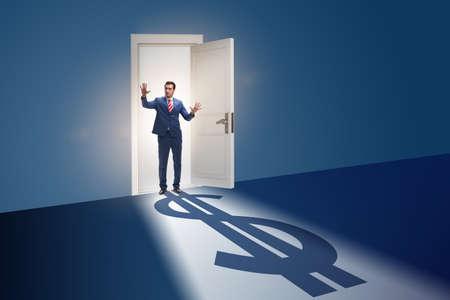 Businessman casting shadow in dollar shape