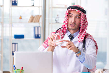 Arab doctor stomatologist working in the clinic