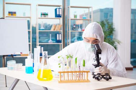 Male biotechnology scientist chemist working in the lab
