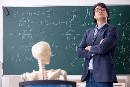 Young male math teacher and student skeleton Banque d'images - 120796902