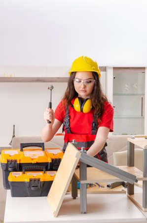 Female contractor repairing furniture at home