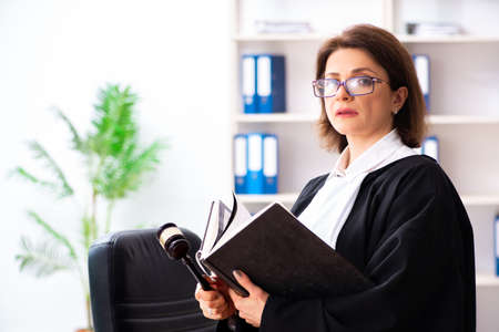 Middle-aged female doctor working in courthouse
