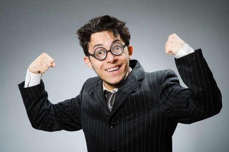 Funny nerd businessman in dark studio