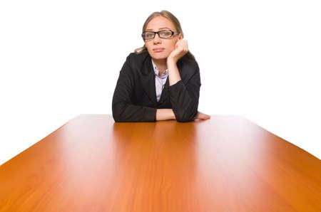 Female employee sitting at long table isolated on white Reklamní fotografie