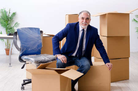 Aged businessman moving to new workplace Stock Photo
