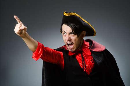 Man pirate against dark background