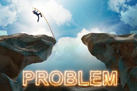 Businessman jumping over burning problems Reklamní fotografie