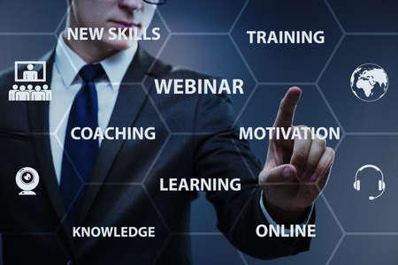 Businessman in online webinar concept Stock Photo