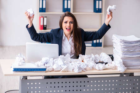 Businesswoman rejecting new ideas with lots of papers 免版税图像