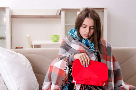Sick young woman suffering at home Stock fotó