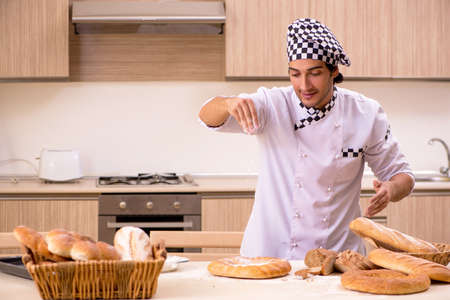 Young male baker working in kitchen