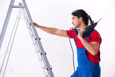 Young handsome contractor working indoors Stock Photo - 121192469