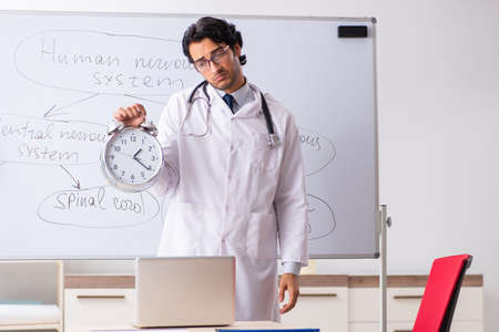 Young male doctor neurologist in front of whiteboard Stok Fotoğraf