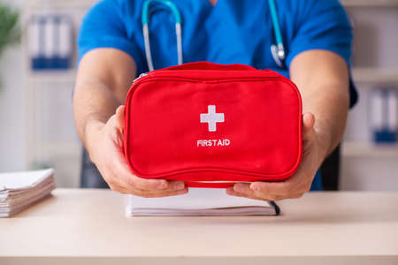 Male doctor with first aid bag