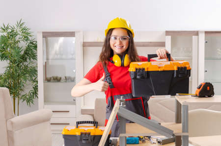 Female contractor repairing furniture at home