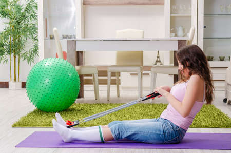 Young beautiful woman doing exercises at home