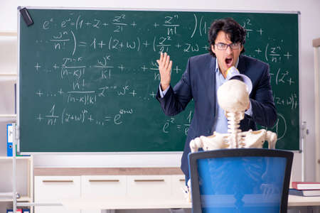 Young male math teacher and student skeleton Фото со стока