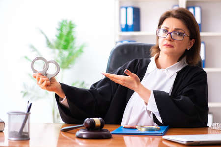 Middle-aged female doctor working in courthouse Reklamní fotografie