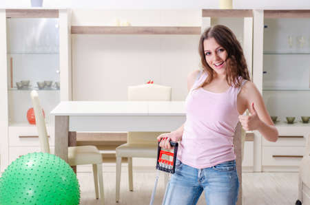 Young beautiful woman doing exercises at home Stock Photo