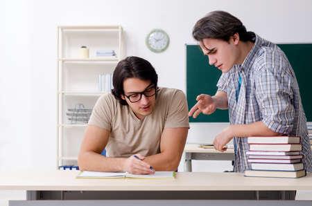 Two male students in the classroom Archivio Fotografico