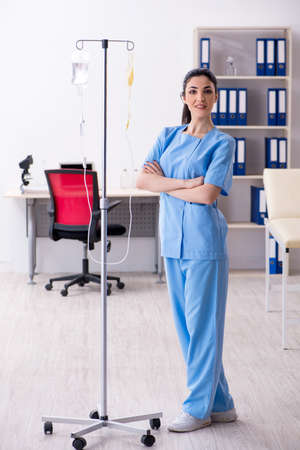 Young female doctor in infusion concept
