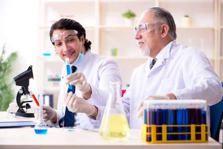 Two chemists working in the lab Stok Fotoğraf