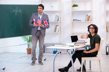 Male english teacher and student in the classroom