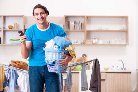 Young man husband doing clothing ironing at home Фото со стока - 121901180