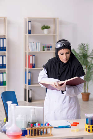 Female chemist in hijab working in the lab 写真素材