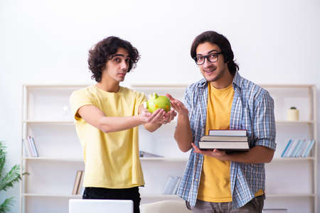 Two male students in the classroom Stock Photo