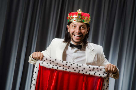 Funny king wearing crown in coronation concept Stock Photo